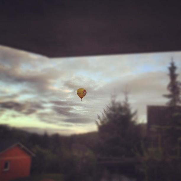 A hot air balloon on a cloudy sky