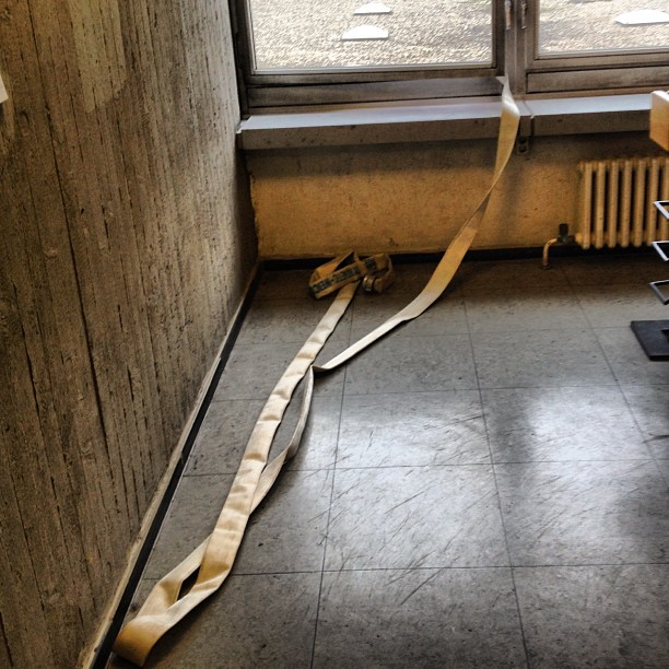 A firehose coming into a building through a window